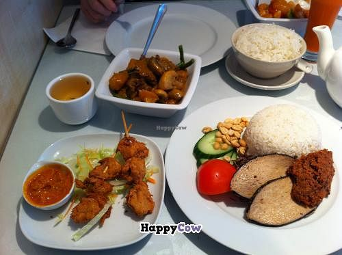 """Photo of Veggie World  by <a href=""""/members/profile/Icahlua"""">Icahlua</a> <br/>Veggie Ji Skewers (veggie soya chicken with satay sauce), Rendang Curry (veggie mutton curry), Sweet & Sour Veggie Prawn, Steamed Rice & Nasi Lemak (veggie fish steaks, veggie shrimp paste, steamed rice, peanuts, salad) <br/> August 31, 2013  - <a href='/contact/abuse/image/649/54108'>Report</a>"""
