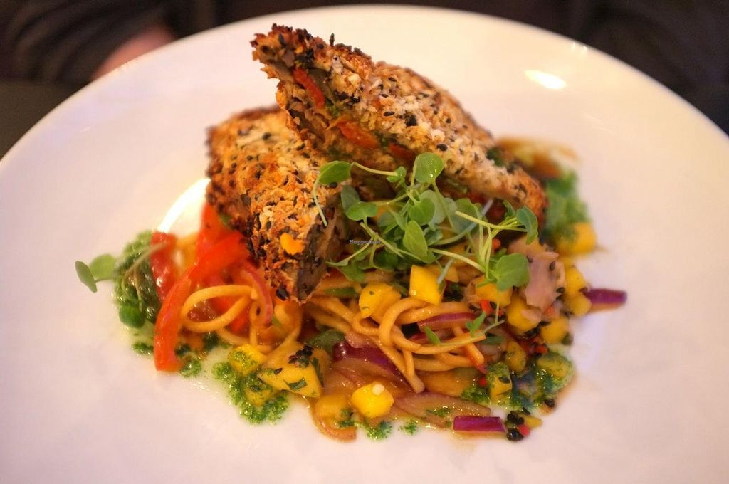 """Photo of The Gate - Hammersmith  by <a href=""""/members/profile/Barbara%20Primo"""">Barbara Primo</a> <br/>Teriyaki aubergine V Char grilled aubergine layered with coriander pesto, roasted red peppers, shitake mushrooms and fresh horseradish, coated with crispy breadcrumbs and served on stir fried noodles with a pickled ginger and mango salad <br/> May 25, 2014  - <a href='/contact/abuse/image/698/70714'>Report</a>"""