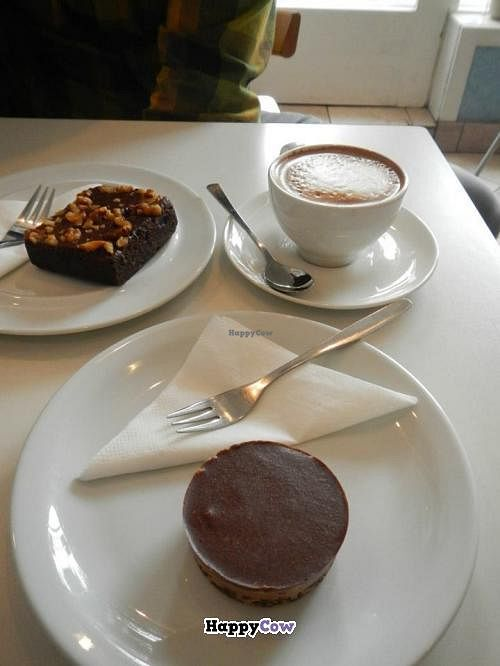 """Photo of Kaffihusid Gardurinn - Ecstasy's Heart-Garden  by <a href=""""/members/profile/Meggie%20and%20Ben"""">Meggie and Ben</a> <br/>Vegan banana and spelt brownie, soy cappuccino, and vegan 'snickers' raw pie cup <br/> July 21, 2013  - <a href='/contact/abuse/image/954/51861'>Report</a>"""