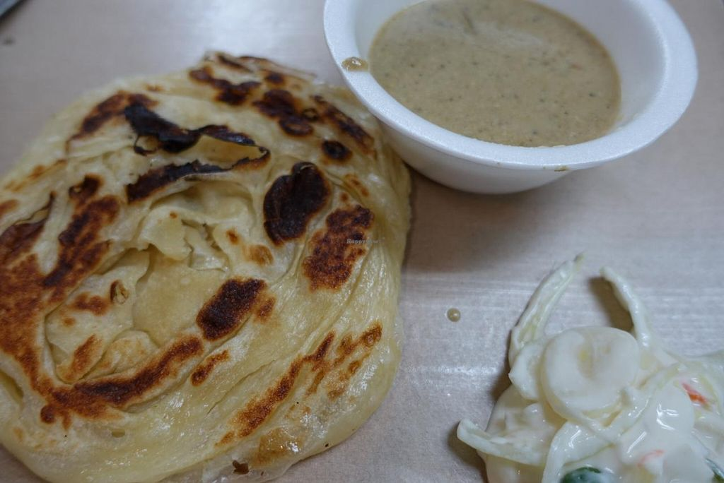 "Photo of Arya Restaurant  by <a href=""/members/profile/JimmySeah"">JimmySeah</a> <br/>prata (without egg) with curry and onion salad <br/> January 5, 2015  - <a href='/contact/abuse/image/10007/89571'>Report</a>"