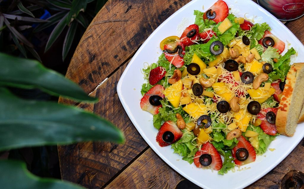 """Photo of Naturalia Cafe  by <a href=""""/members/profile/naturalistas"""">naturalistas</a> <br/>Ensalada Tropical with Strawberries, Mango, Black Olives and Cashew Nuts <br/> September 8, 2017  - <a href='/contact/abuse/image/100432/302211'>Report</a>"""