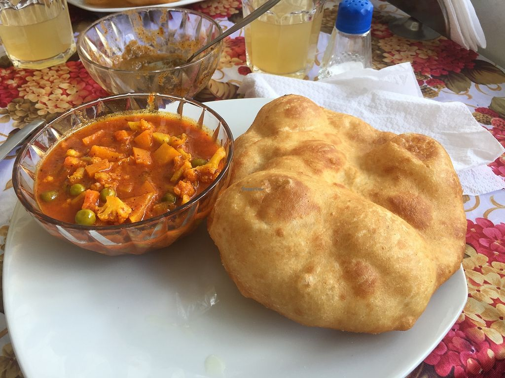 "Photo of Krishna Bhog  by <a href=""/members/profile/joegelay"">joegelay</a> <br/>Puffy bread and perfectly spiced curry! <br/> December 20, 2017  - <a href='/contact/abuse/image/100551/337383'>Report</a>"