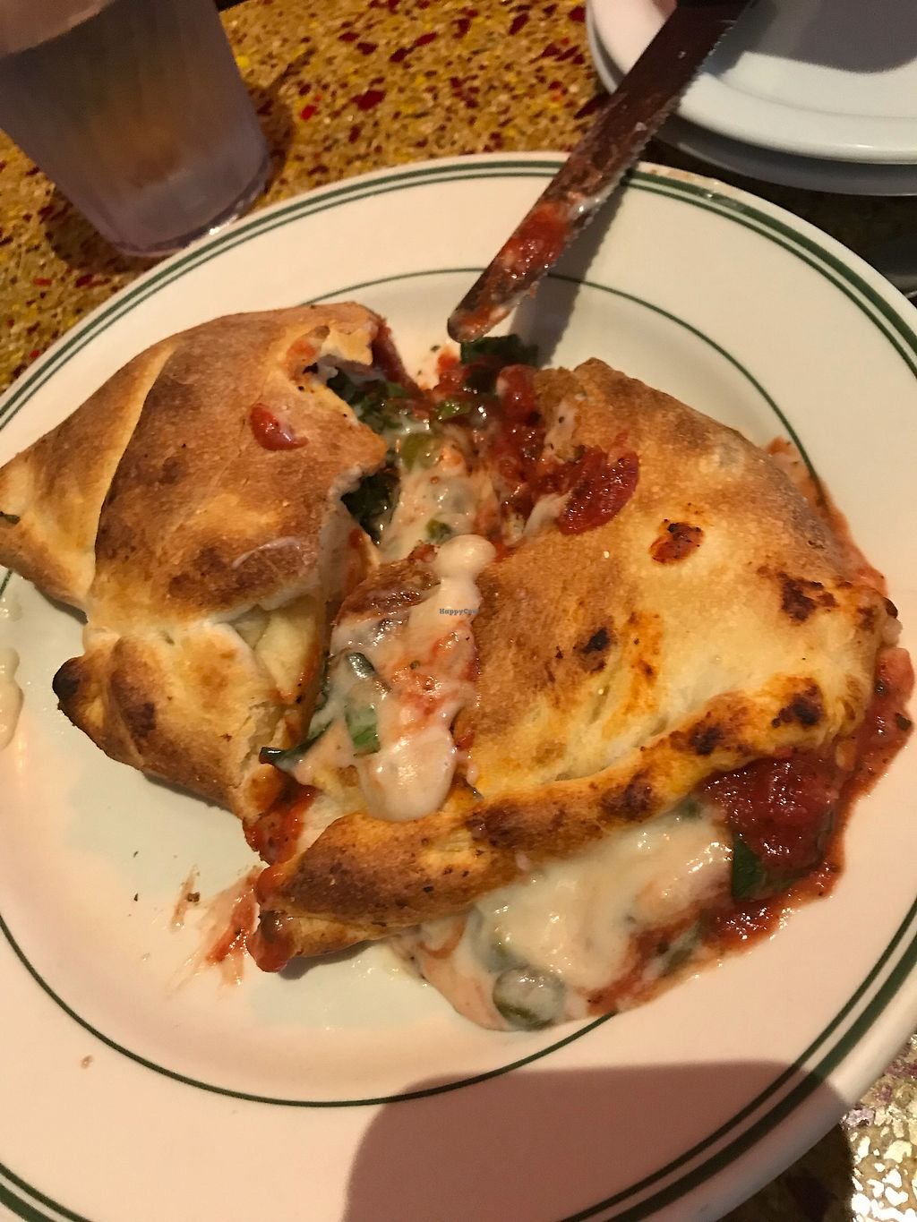 "Photo of CyBelle's Front Room  by <a href=""/members/profile/Rachelmpowers"">Rachelmpowers</a> <br/>Vegan calzone !! ( sliced into ) <br/> January 1, 2018  - <a href='/contact/abuse/image/100785/341519'>Report</a>"