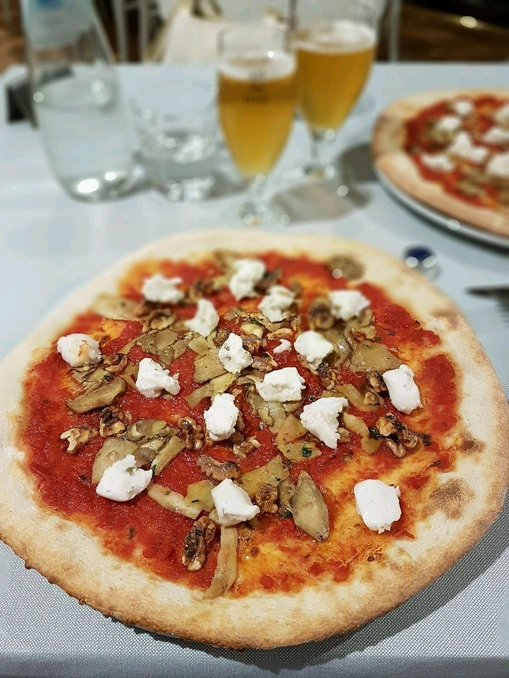 """Photo of Calico Ristorante Pizzeria  by <a href=""""/members/profile/MarinaZago"""">MarinaZago</a> <br/>Pizza with porcini mushrooms, nuts and """"strachicco"""" (rice cheese)  <br/> September 26, 2017  - <a href='/contact/abuse/image/100919/308816'>Report</a>"""