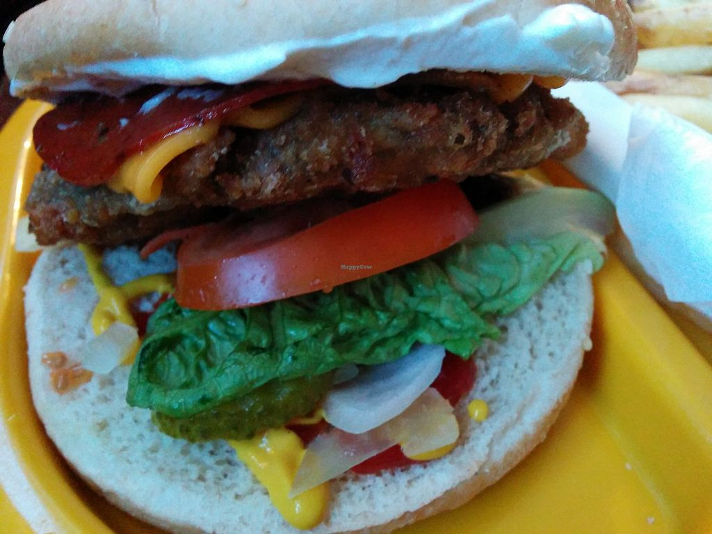 """Photo of The Caledonia  by <a href=""""/members/profile/CLRtraveller"""">CLRtraveller</a> <br/>pizza-style burger <br/> March 9, 2018  - <a href='/contact/abuse/image/100975/368459'>Report</a>"""