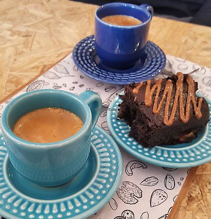 """Photo of Holy Nuts Cafe  by <a href=""""/members/profile/sarahssoares"""">sarahssoares</a> <br/>Coffee and vegan brownie <br/> September 15, 2017  - <a href='/contact/abuse/image/101020/304718'>Report</a>"""