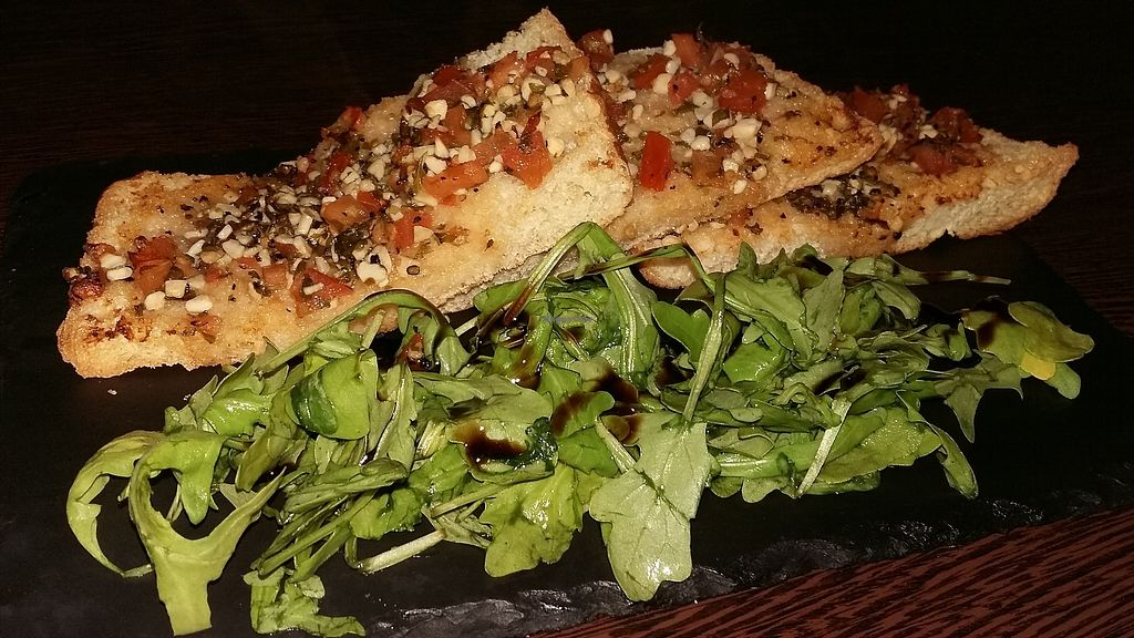 "Photo of Rock Garden  by <a href=""/members/profile/Vegan-Vinyl-Avengers"">Vegan-Vinyl-Avengers</a> <br/>Vegan tomato bruschetta <br/> September 24, 2017  - <a href='/contact/abuse/image/101055/307805'>Report</a>"