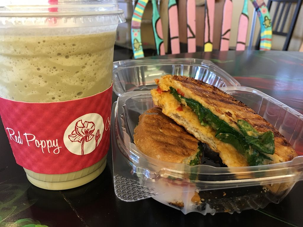 """Photo of Red Poppy Coffee  by <a href=""""/members/profile/ErinBossMcDonald"""">ErinBossMcDonald</a> <br/>Zen matcha with soy and a reference panini <br/> March 2, 2018  - <a href='/contact/abuse/image/101242/365885'>Report</a>"""