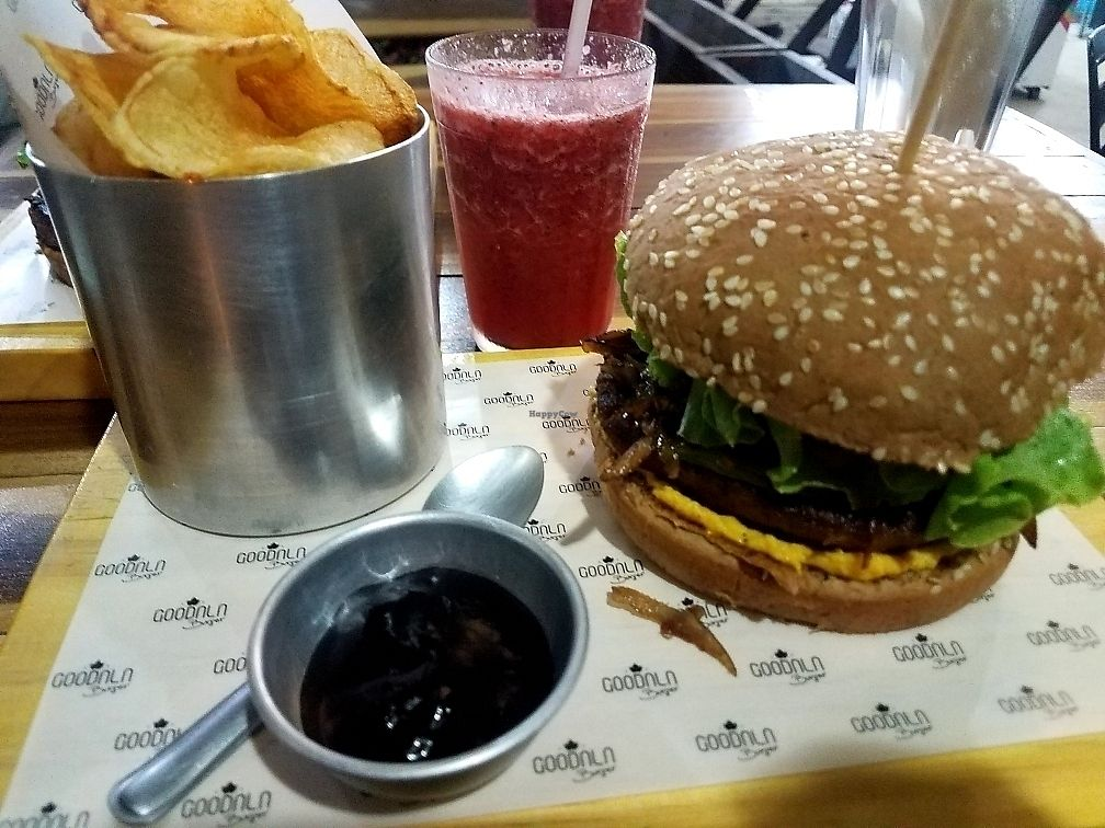 "Photo of Goodala Burger  by <a href=""/members/profile/NatalieMayer"">NatalieMayer</a> <br/>Soy burger, vegan cheddar, coconut ""bacon"", greens, tomato and carmelized onions, fresh chips, guava bbq sauce and a strawberry mint juice!!  <br/> March 30, 2018  - <a href='/contact/abuse/image/101504/378045'>Report</a>"