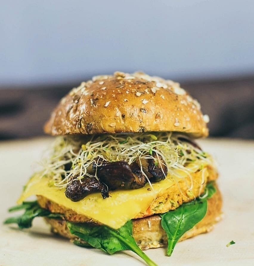 """Photo of Bareburger  by <a href=""""/members/profile/Bareburgerlakeview"""">Bareburgerlakeview</a> <br/>Prairie Burger: farmer's quinoa patty, vegan American, balsamic roasted mushrooms and garlic caramelizad onions, baby spinach, alfalfa on sprout bun <br/> September 25, 2017  - <a href='/contact/abuse/image/101660/308413'>Report</a>"""