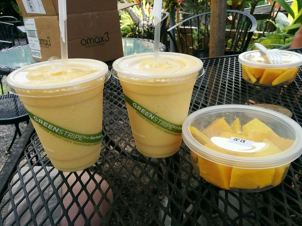 """Photo of The South Kona Fruit Stand  by <a href=""""/members/profile/alexandra_vegan"""">alexandra_vegan</a> <br/>Smoothie no 4 and fresh cut mango. Bliss <br/> September 28, 2017  - <a href='/contact/abuse/image/101790/309511'>Report</a>"""