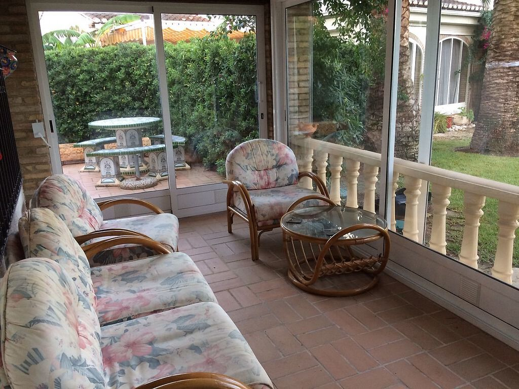 """Photo of Casa Blanca  by <a href=""""/members/profile/Gracie10"""">Gracie10</a> <br/>The comfy, airy porch and garden  <br/> February 15, 2018  - <a href='/contact/abuse/image/101791/359757'>Report</a>"""