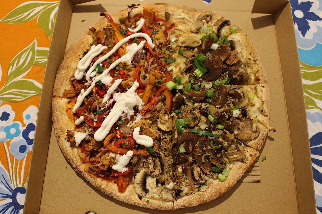 """Photo of Crust Gourmet Pizza Bar  by <a href=""""/members/profile/ericacrombie"""">ericacrombie</a> <br/>Half smokey bbq pulled jackfruit and half herb crusted al funghi pizza <br/> October 18, 2017  - <a href='/contact/abuse/image/101930/316237'>Report</a>"""