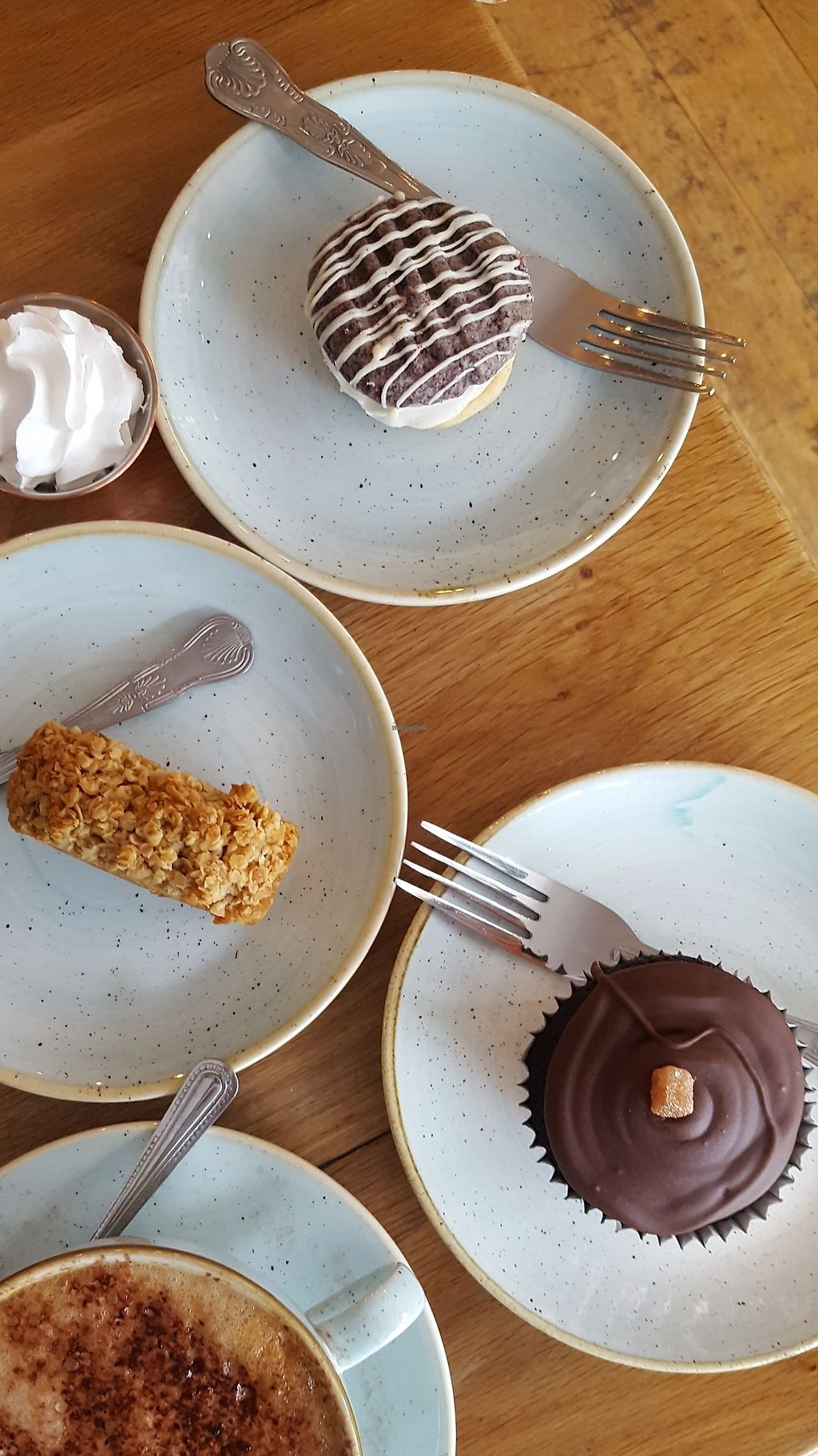"""Photo of The Copper Spoon  by <a href=""""/members/profile/VeganAnnaS"""">VeganAnnaS</a> <br/>Vegan cakes - blueberry biscuit sandwich / flapjack / chocolate and ginger cupcake <br/> October 14, 2017  - <a href='/contact/abuse/image/102406/315175'>Report</a>"""