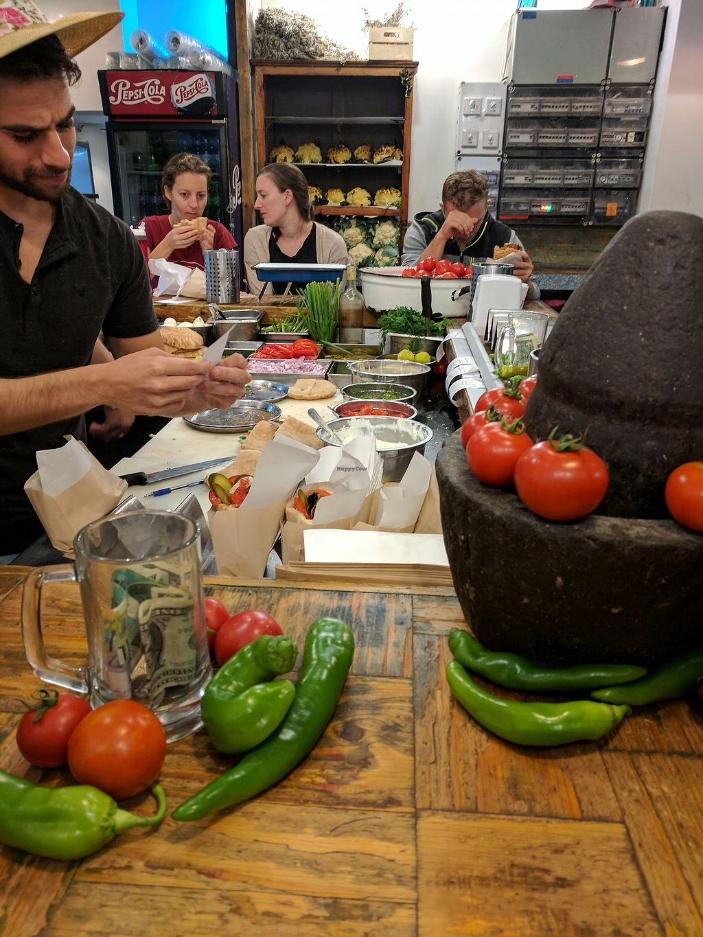 """Photo of Miznon - Ibn Gabirol  by <a href=""""/members/profile/eee135"""">eee135</a> <br/>Counter preparing food <br/> October 11, 2017  - <a href='/contact/abuse/image/102738/314308'>Report</a>"""