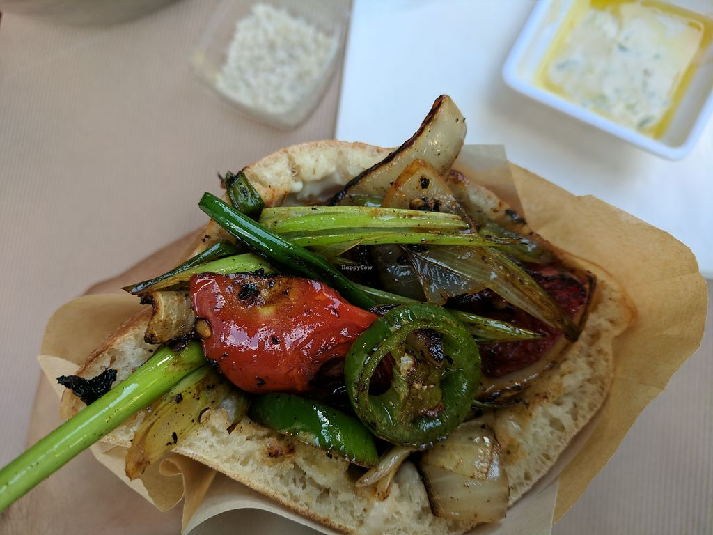"""Photo of Miznon - HaNehoshet  by <a href=""""/members/profile/eee135"""">eee135</a> <br/>Red - tomato and onion pita <br/> April 21, 2018  - <a href='/contact/abuse/image/102739/389049'>Report</a>"""