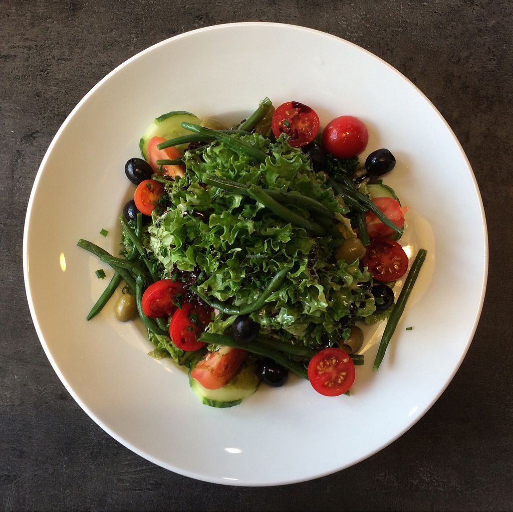 "Photo of Cafe Grau  by <a href=""/members/profile/Carissima"">Carissima</a> <br/>Salad of mixed leaf lettuces, haricots verts, cherry tomatoes, and olives, drizzled with pumpkin seed oil <br/> October 26, 2017  - <a href='/contact/abuse/image/102866/319002'>Report</a>"