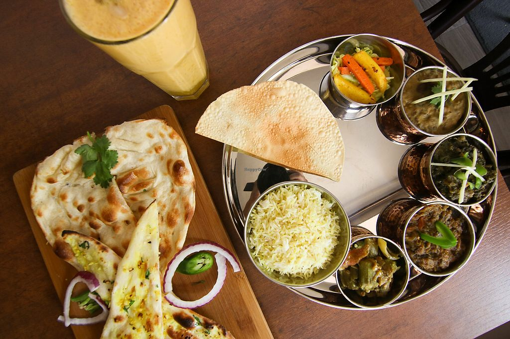 "Photo of Hindusthali  by <a href=""/members/profile/hindusthali"">hindusthali</a> <br/>Thali C with Mango Lassi and Naan bread <br/> December 3, 2017  - <a href='/contact/abuse/image/103162/331669'>Report</a>"
