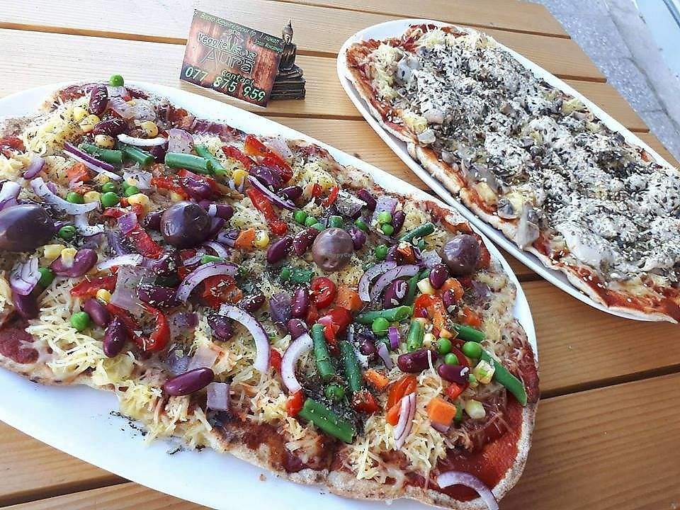 "Photo of Veggie Bar Aura  by <a href=""/members/profile/Nefelibata"">Nefelibata</a> <br/>Different vegan and vegetarian pizza types and tastes <br/> October 21, 2017  - <a href='/contact/abuse/image/103218/317336'>Report</a>"