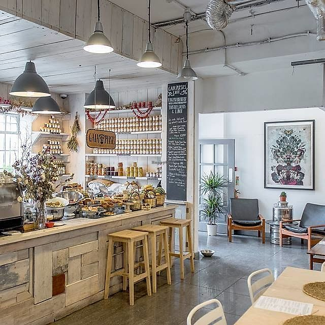 """Photo of The Old Baths Cafe  by <a href=""""/members/profile/YoliTengos"""">YoliTengos</a> <br/>A Greek Oasis hidden in The Old Baths of Hackney Wick. It could be the set of a Wes Anderson movie, or just a quirky Farm Shop, with sacks of Beans and Lentils on display, homemade preserves, Frankincense and Soaps.  <br/> November 1, 2017  - <a href='/contact/abuse/image/103351/320800'>Report</a>"""