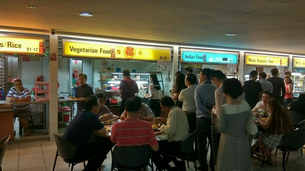 """Photo of Singtel Comcentre Vegetarian Stall  by <a href=""""/members/profile/JimmySeah"""">JimmySeah</a> <br/>long queue in front of stall <br/> October 23, 2017  - <a href='/contact/abuse/image/103421/317878'>Report</a>"""