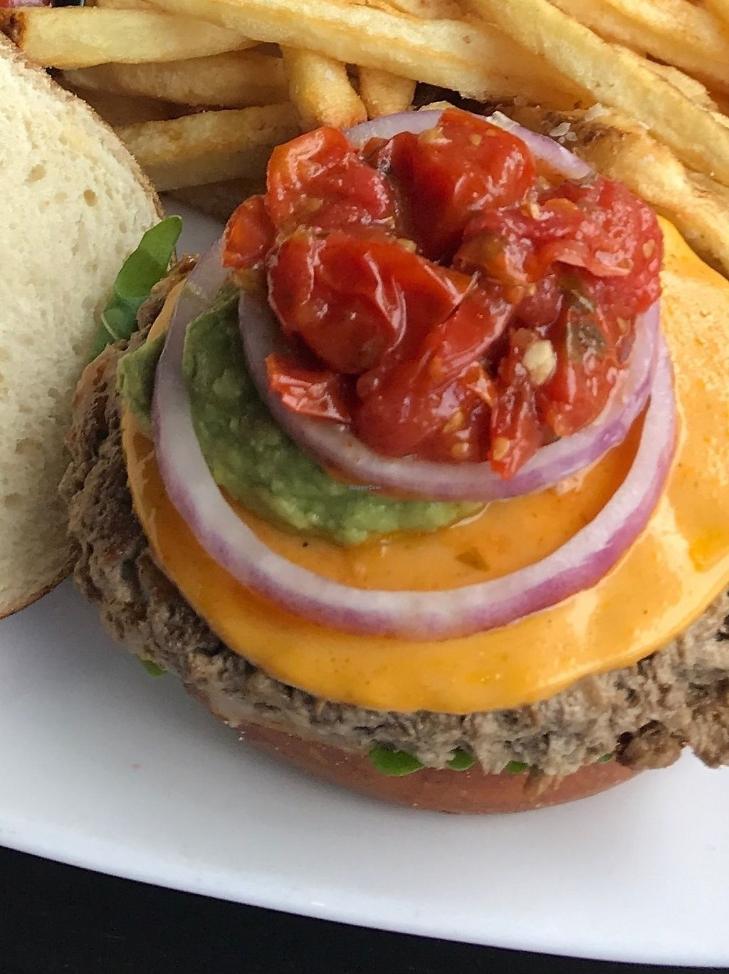 """Photo of Kuma's Corner  by <a href=""""/members/profile/Klrogers62"""">Klrogers62</a> <br/>Food was VERY good.  While visiting the Chicago area we found this place!  The burger pictured is called the Converge 6oz Impossible Burger, Cherry Tomato Jam, Avocado Mash, Cheddar (v), Roasted Garlic Mayo (v), Baby Arugula, Red Onion.  Fries are technically not vegan so my husband ate those.   <br/> December 9, 2017  - <a href='/contact/abuse/image/103445/334103'>Report</a>"""