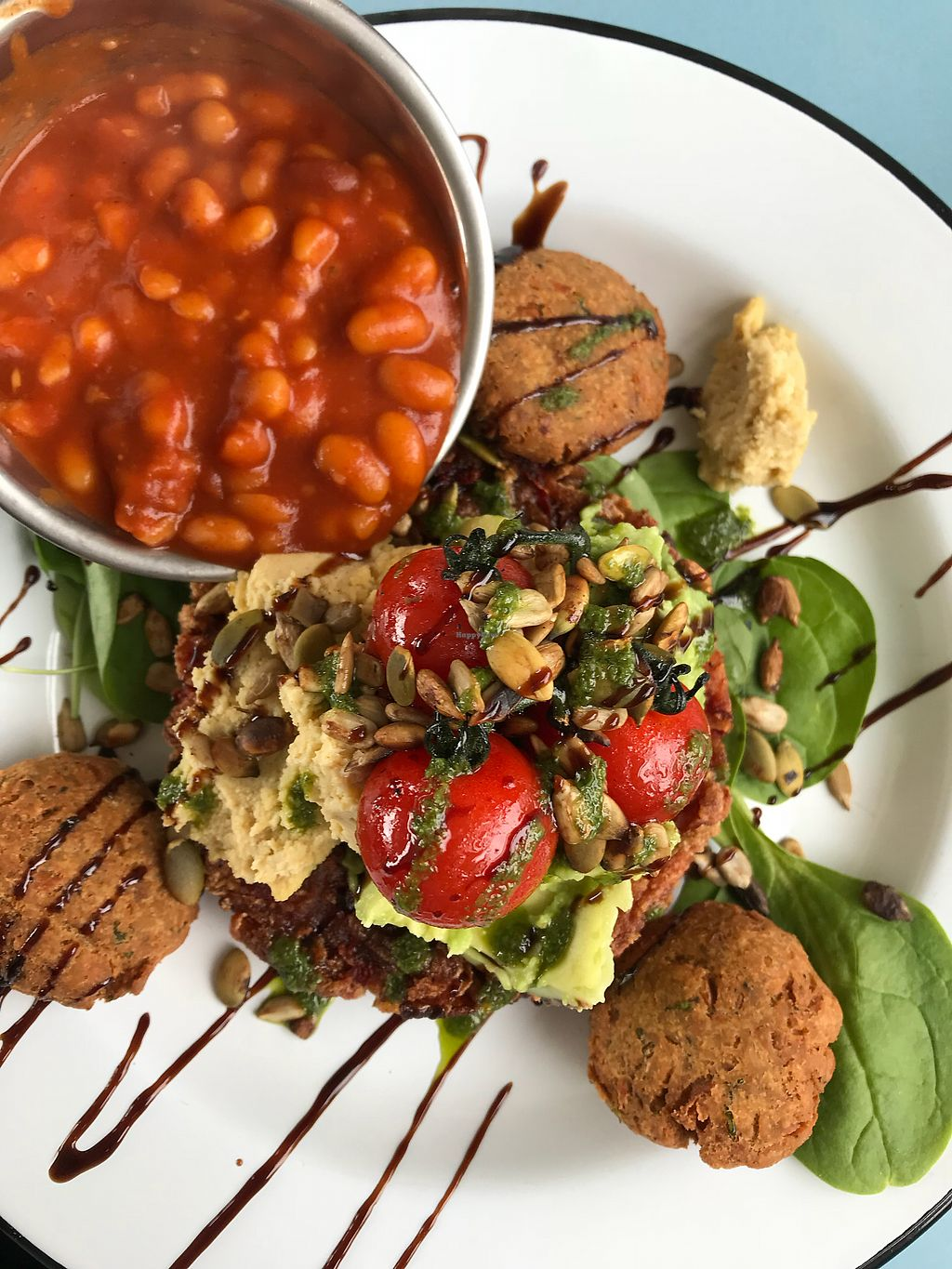"""Photo of The Bus Cafe  by <a href=""""/members/profile/Love%20to%20munch"""">Love to munch</a> <br/>Breakfast falafel stack  <br/> February 8, 2018  - <a href='/contact/abuse/image/103688/356555'>Report</a>"""