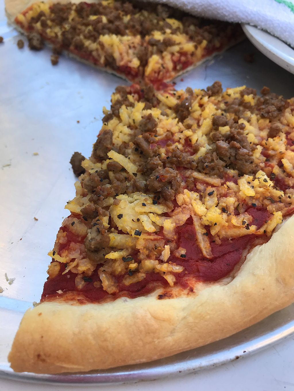 """Photo of The Pizza Patio  by <a href=""""/members/profile/Justusveggies"""">Justusveggies</a> <br/>Vegan Italian sausage and shredded polenta """"cheese""""  <br/> October 26, 2017  - <a href='/contact/abuse/image/103761/319113'>Report</a>"""