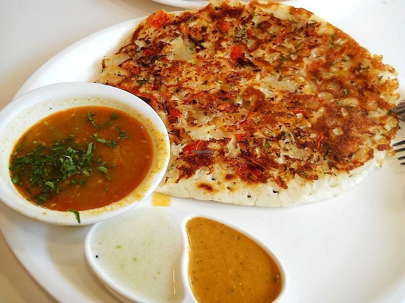 "Photo of Angan - Lazimpat Rd  by <a href=""/members/profile/Masala-Dosa"">Masala-Dosa</a> <br/>Tomato Onion Uttapam <br/> October 29, 2017  - <a href='/contact/abuse/image/103834/319674'>Report</a>"