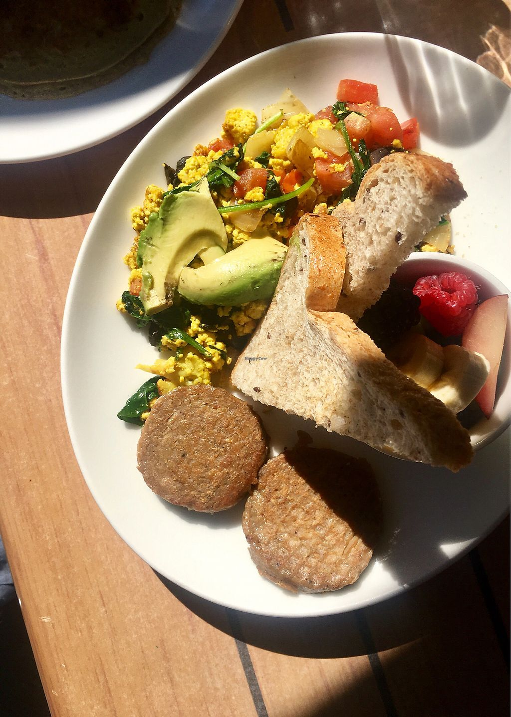 """Photo of Sleepy Bee Cafe  by <a href=""""/members/profile/Jaclynch_eats"""">Jaclynch_eats</a> <br/>Tofu scramble, vegan sausage, toast & fruit <br/> March 6, 2018  - <a href='/contact/abuse/image/103854/367278'>Report</a>"""