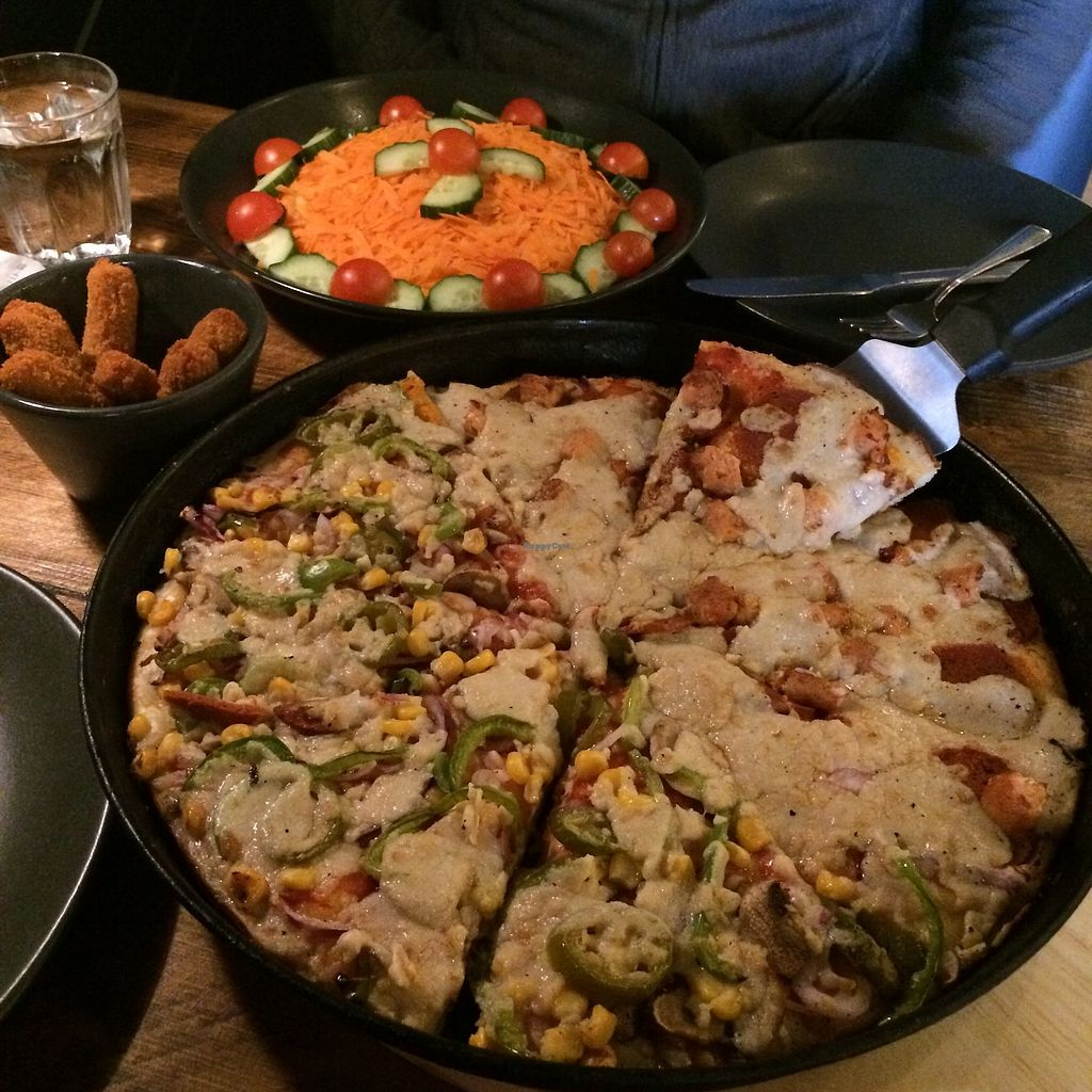 """Photo of Mr Singh's  by <a href=""""/members/profile/Hoggy"""">Hoggy</a> <br/>Half & Half Vegan pizza: Left side - Vegetarian Supreme. Right side - Veggie Meat Feast. Plain Salad and Spicy Soya Sticks <br/> November 1, 2017  - <a href='/contact/abuse/image/104118/320929'>Report</a>"""