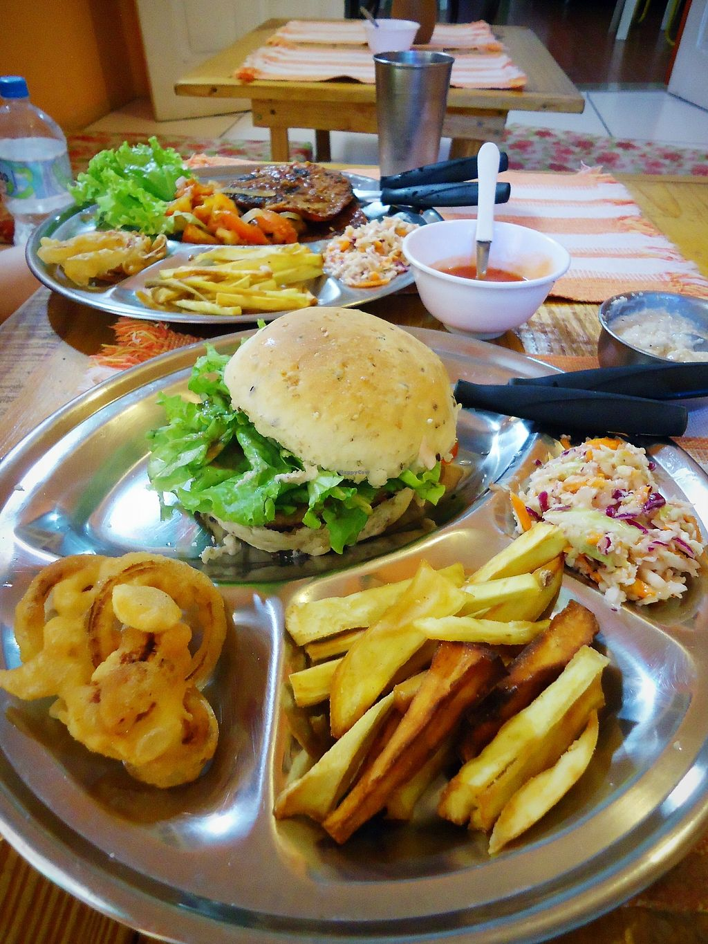 """Photo of Centro Cultural Annapurna  by <a href=""""/members/profile/WayneB"""">WayneB</a> <br/>USA day, vegan burger, onion rings, sweet potato fries, mayo, tomato sauce <br/> November 6, 2017  - <a href='/contact/abuse/image/104191/322400'>Report</a>"""