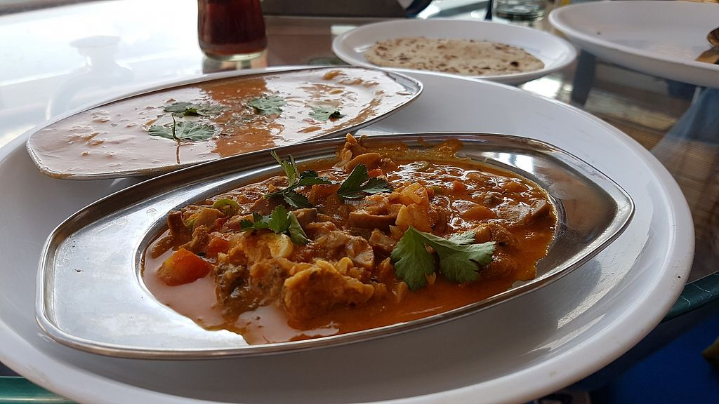 """Photo of Pushkar Meeting Point Cafe  by <a href=""""/members/profile/mon1que"""">mon1que</a> <br/>Vegan cashew curry with soy milk and a vegetable mix, with chapati as a side <br/> January 8, 2018  - <a href='/contact/abuse/image/104346/344466'>Report</a>"""