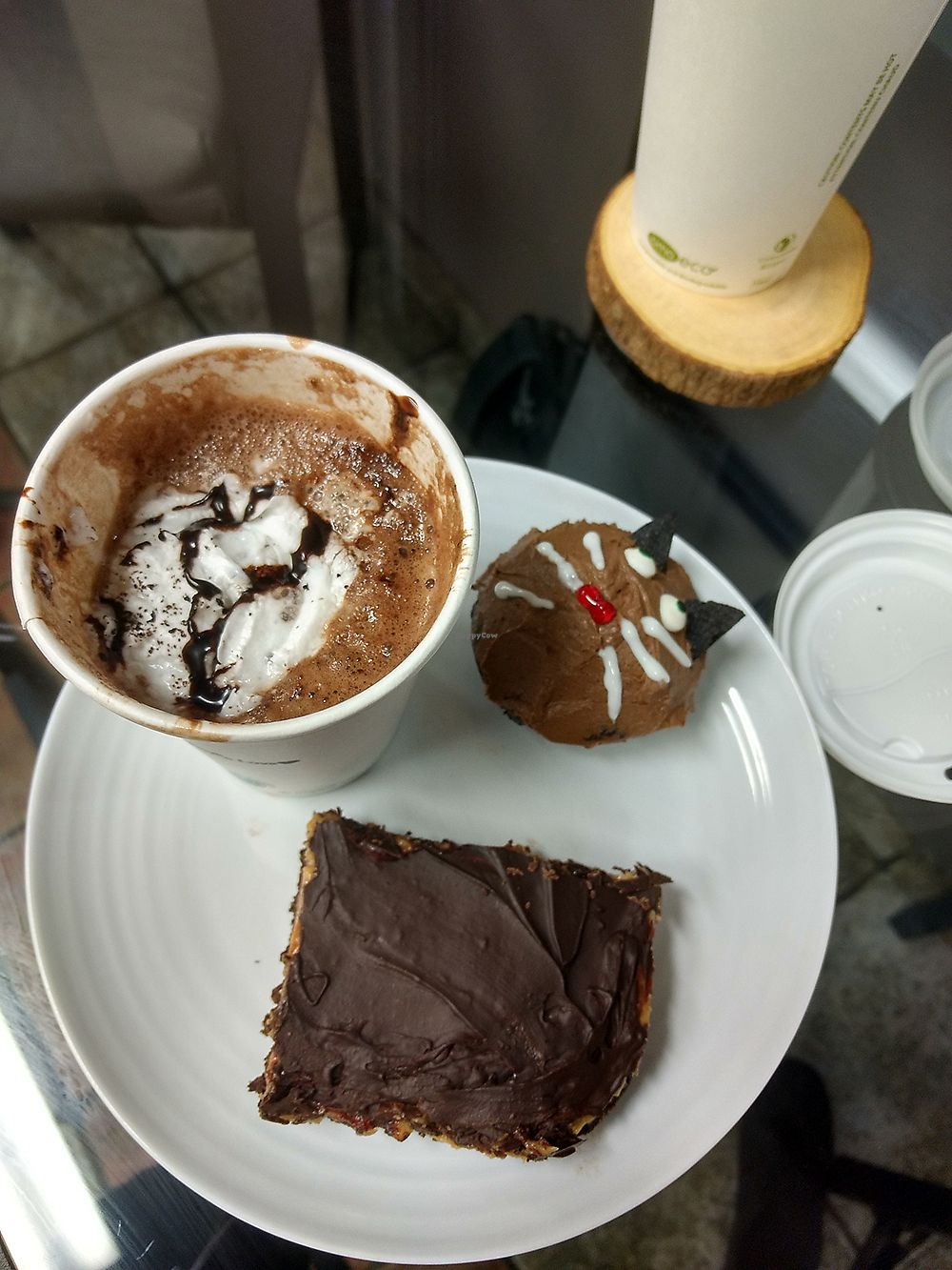 "Photo of VegaBoo Cat Haven  by <a href=""/members/profile/KinaFay"">KinaFay</a> <br/>Hot chocolate, peanut butter nanaimo bar and muffic. Vegan <br/> November 7, 2017  - <a href='/contact/abuse/image/104369/322885'>Report</a>"