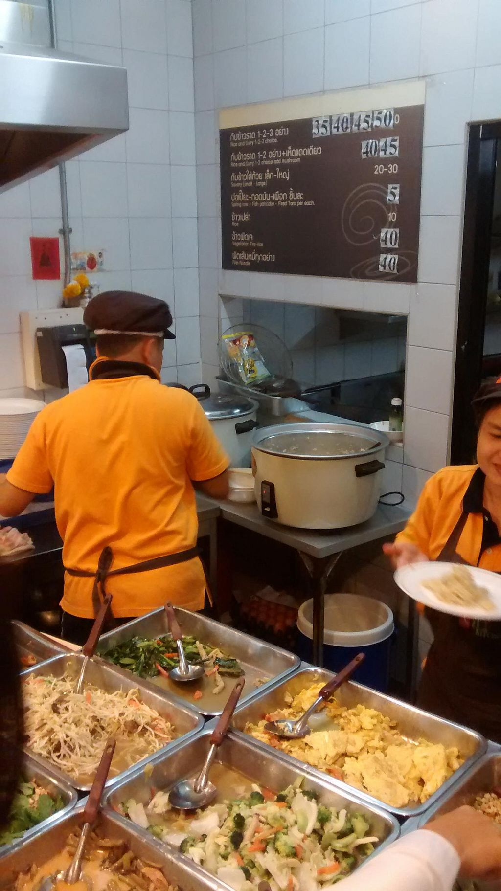 Photo of Vegetarian Food Stall - Ploenjit  by zungi <br/>behind the counter <br/> December 15, 2014  - <a href='/contact/abuse/image/10441/88057'>Report</a>