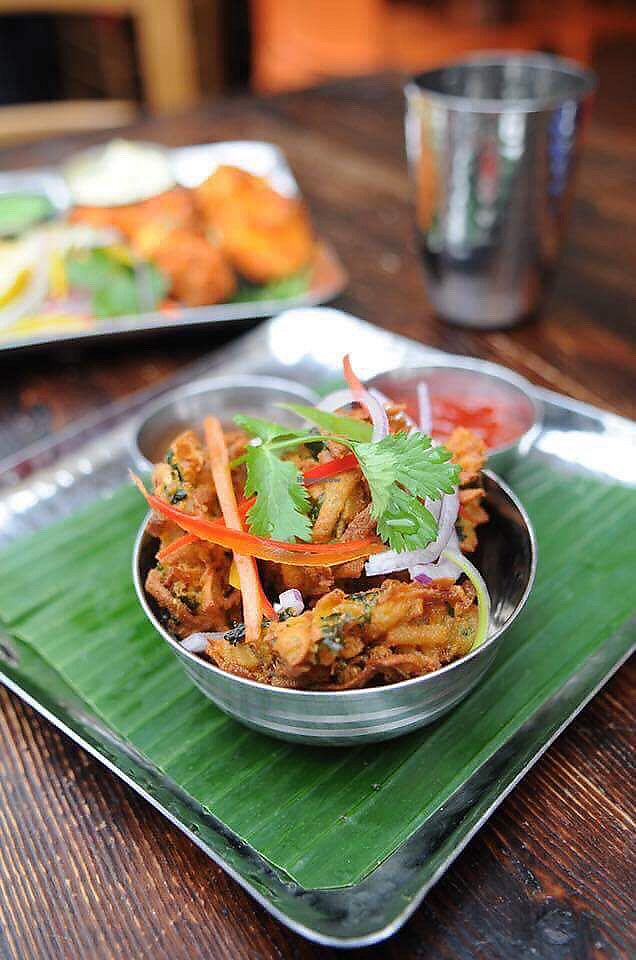 "Photo of Cafe Diwali  by <a href=""/members/profile/tamasinemmacook"">tamasinemmacook</a> <br/>Kale and parsnip pakora <br/> November 7, 2017  - <a href='/contact/abuse/image/104421/323040'>Report</a>"