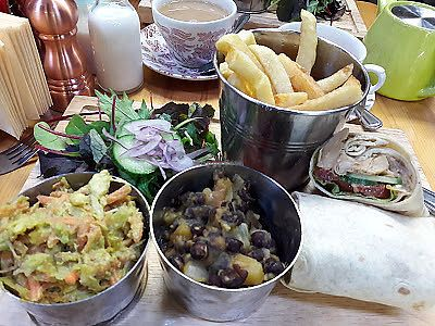 "Photo of The Barn  by <a href=""/members/profile/Veganolive1"">Veganolive1</a> <br/>Jerk jackfruit wrap with fries, avocado slaw & mango & black bean salsa  <br/> November 17, 2017  - <a href='/contact/abuse/image/104612/326503'>Report</a>"