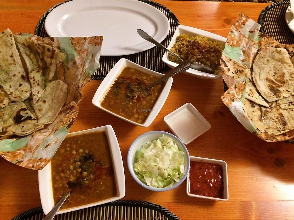 "Photo of Royal Kashmir  by <a href=""/members/profile/KorneliaSochanova"">KorneliaSochanova</a> <br/>yellow pea curry, two kind of indian bread one with fresh minth and second with fresh garlic, curry rice with fried onion <br/> November 12, 2017  - <a href='/contact/abuse/image/104768/324927'>Report</a>"