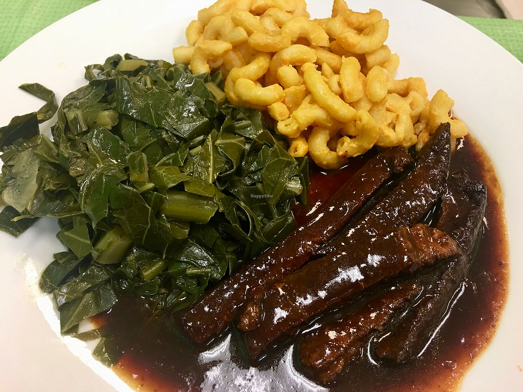 "Photo of Vegan International Co Kitchen & Market  by <a href=""/members/profile/myra975"">myra975</a> <br/>BBQ over Soy Earth Protein, Collards, Mac & Cheese <br/> November 18, 2017  - <a href='/contact/abuse/image/105384/326581'>Report</a>"