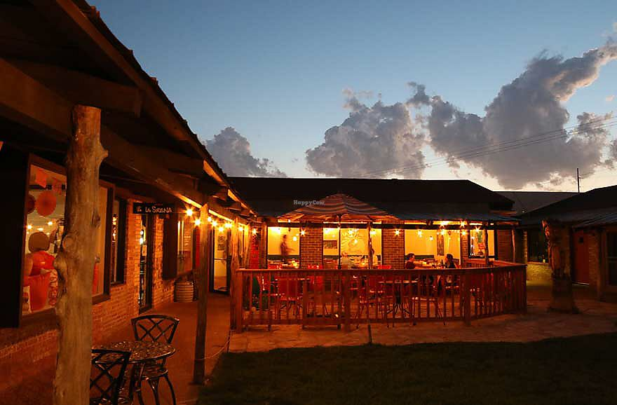 """Photo of Cocina de La Sirena  by <a href=""""/members/profile/JeffJohnson"""">JeffJohnson</a> <br/>Courtyard dining at night <br/> November 24, 2017  - <a href='/contact/abuse/image/105837/328801'>Report</a>"""