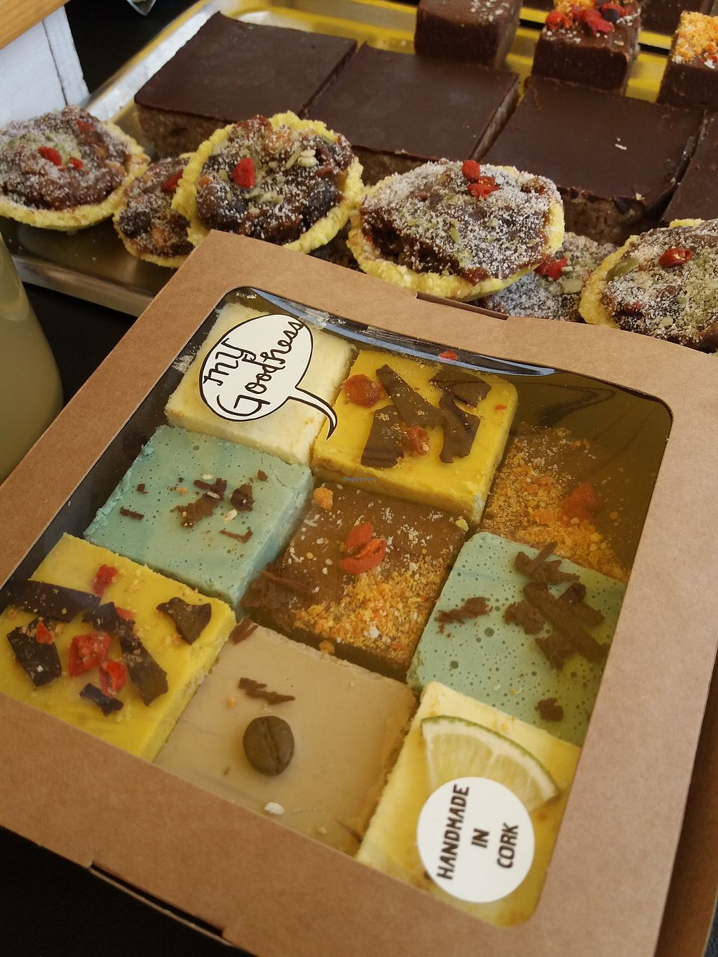 "Photo of My Goodness  by <a href=""/members/profile/TaylorNelsen"">TaylorNelsen</a> <br/>Raw cakes at the My Goodness market stall. Raw vegan truffles, raw vegan mince pies, peanut butter power bars.  <br/> November 26, 2017  - <a href='/contact/abuse/image/105957/329342'>Report</a>"