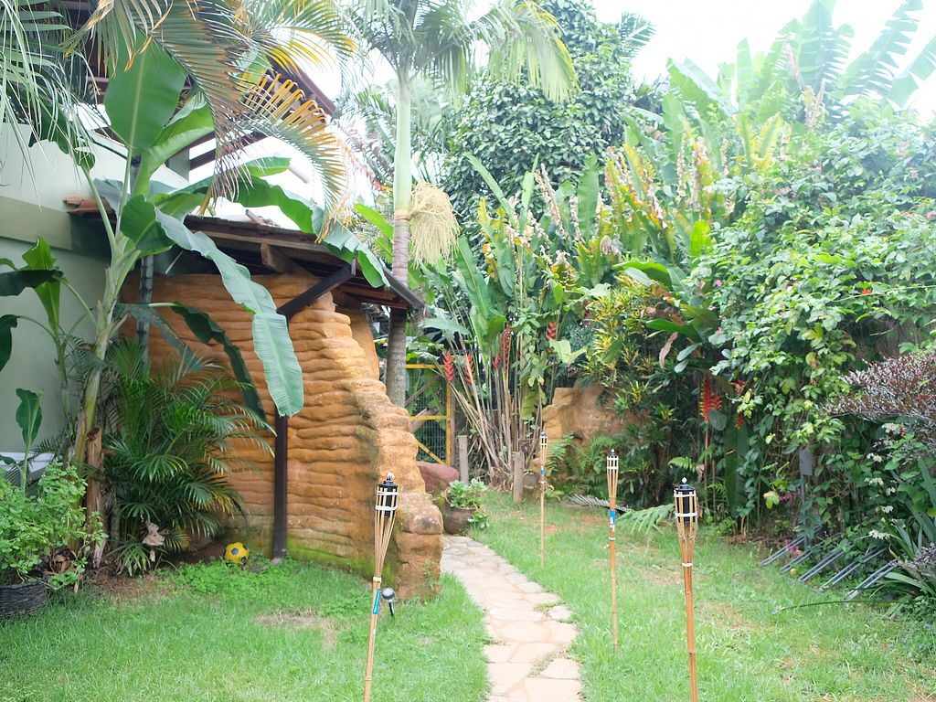"""Photo of Paraty EcoHostel e Restaurante Vegano  by <a href=""""/members/profile/HaileyPoLa"""">HaileyPoLa</a> <br/>Nice little yard after entering the gate  <br/> December 30, 2017  - <a href='/contact/abuse/image/106009/340747'>Report</a>"""