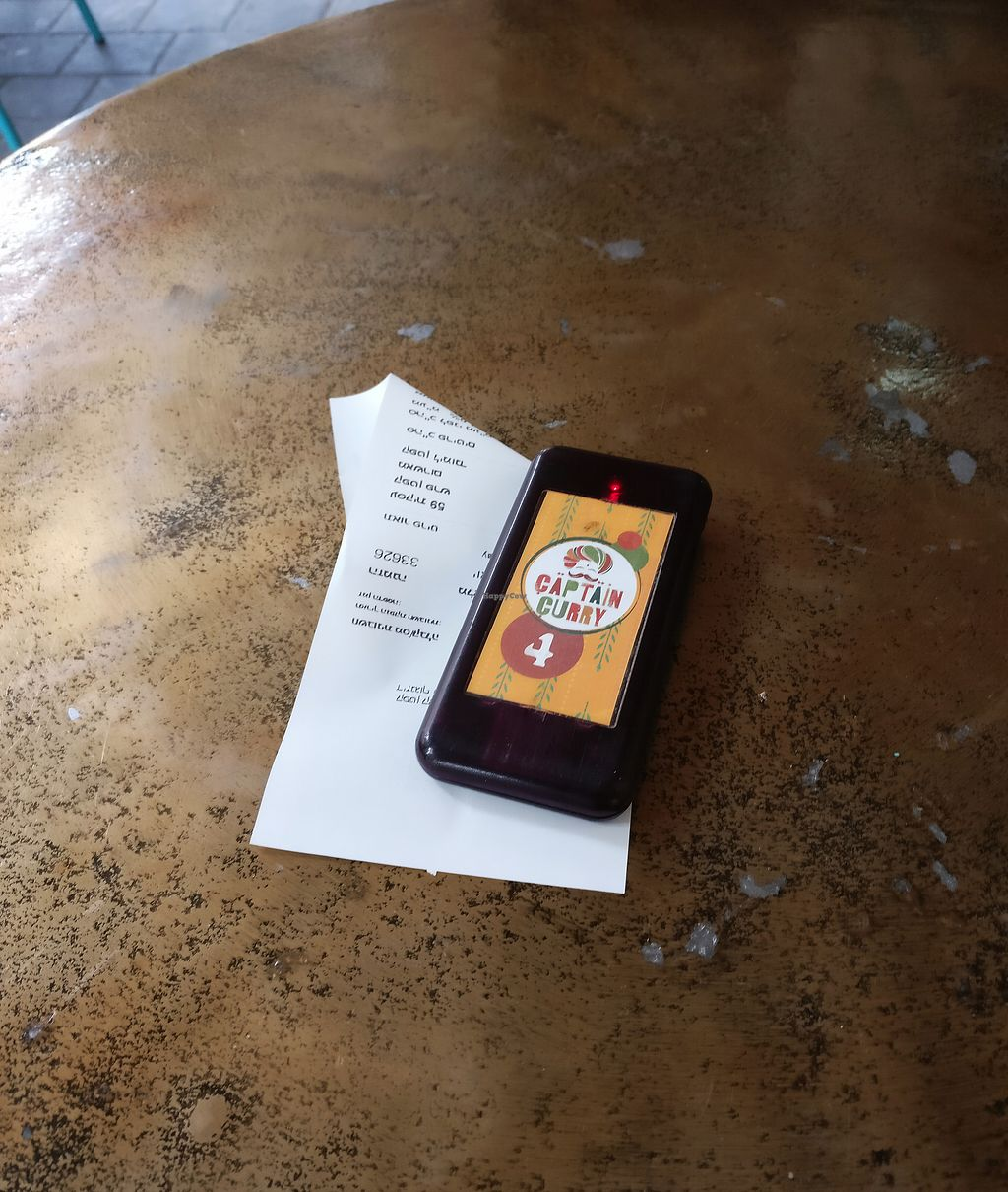 """Photo of CLOSED: Captain Curry  by <a href=""""/members/profile/KarinKoala"""">KarinKoala</a> <br/>you get a small remote control that tell you when your food is ready (the wonders of technology)  <br/> January 17, 2018  - <a href='/contact/abuse/image/106027/347614'>Report</a>"""