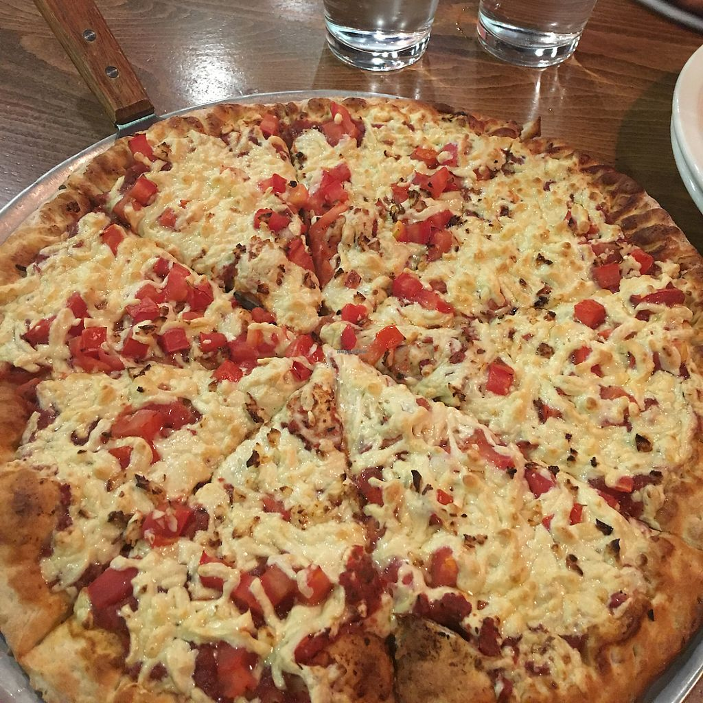 """Photo of Pizza Luce  by <a href=""""/members/profile/SelaHanson"""">SelaHanson</a> <br/>Build your own vegan pizza with daiya cheese, fresh tomatoes, and garlic <br/> May 5, 2017  - <a href='/contact/abuse/image/10614/255997'>Report</a>"""