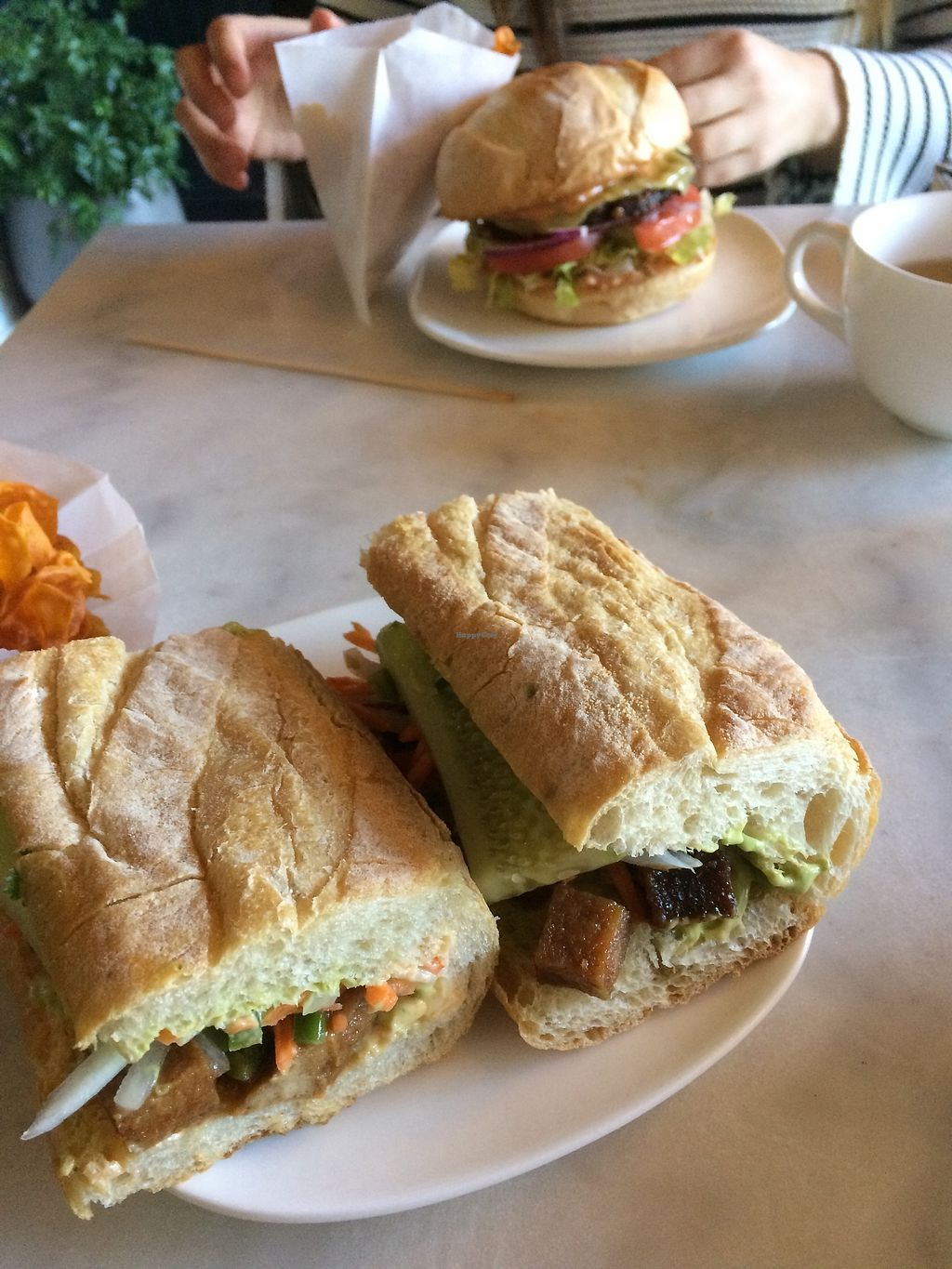 """Photo of Urbavore  by <a href=""""/members/profile/MeganChristineMorale"""">MeganChristineMorale</a> <br/>Diner Burger (Mushroom & lentil) and Banh Mi Chay (Vietnamese Tofu) <br/> March 4, 2018  - <a href='/contact/abuse/image/106548/366768'>Report</a>"""