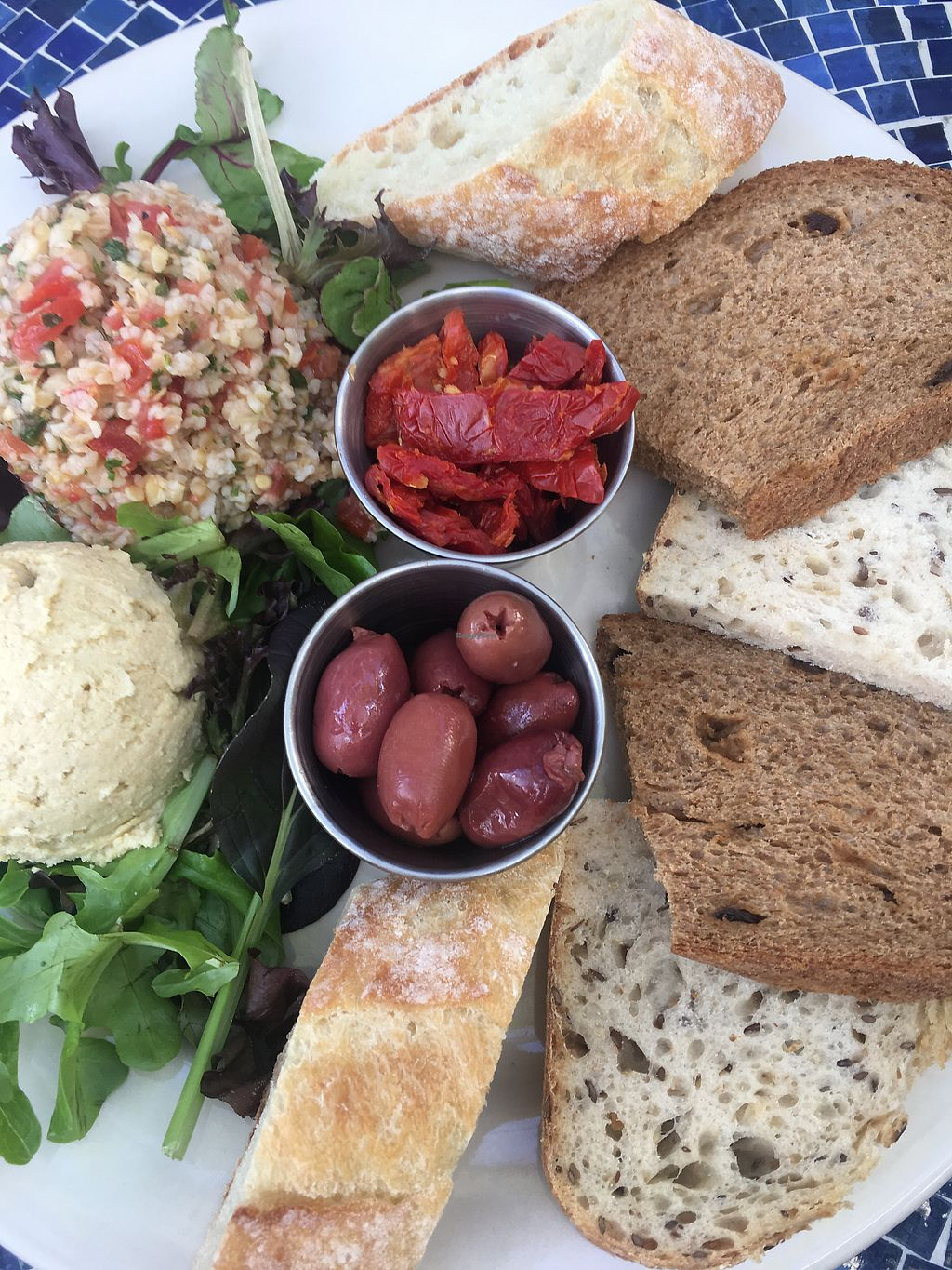 "Photo of Blue Dahlia Bistro  by <a href=""/members/profile/Traveling.Plant_Eater"">Traveling.Plant_Eater</a> <br/>Hummus Plate with Tabouli, Olives and Sun Dried Tomatoes. Perfection! <br/> December 4, 2017  - <a href='/contact/abuse/image/106552/332335'>Report</a>"