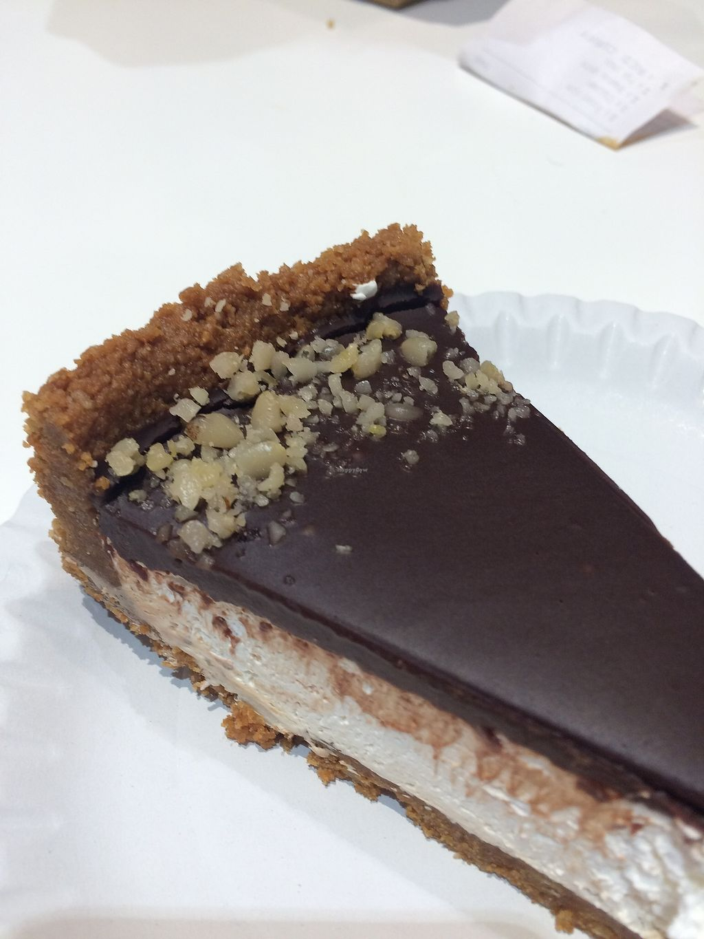 """Photo of Loving Hut - Spalena  by <a href=""""/members/profile/AnetaB%C3%A1rtov%C3%A1"""">AnetaBártová</a> <br/>Lotus cheesecake with creamy and chocolate topping.  <br/> December 9, 2017  - <a href='/contact/abuse/image/106853/333879'>Report</a>"""