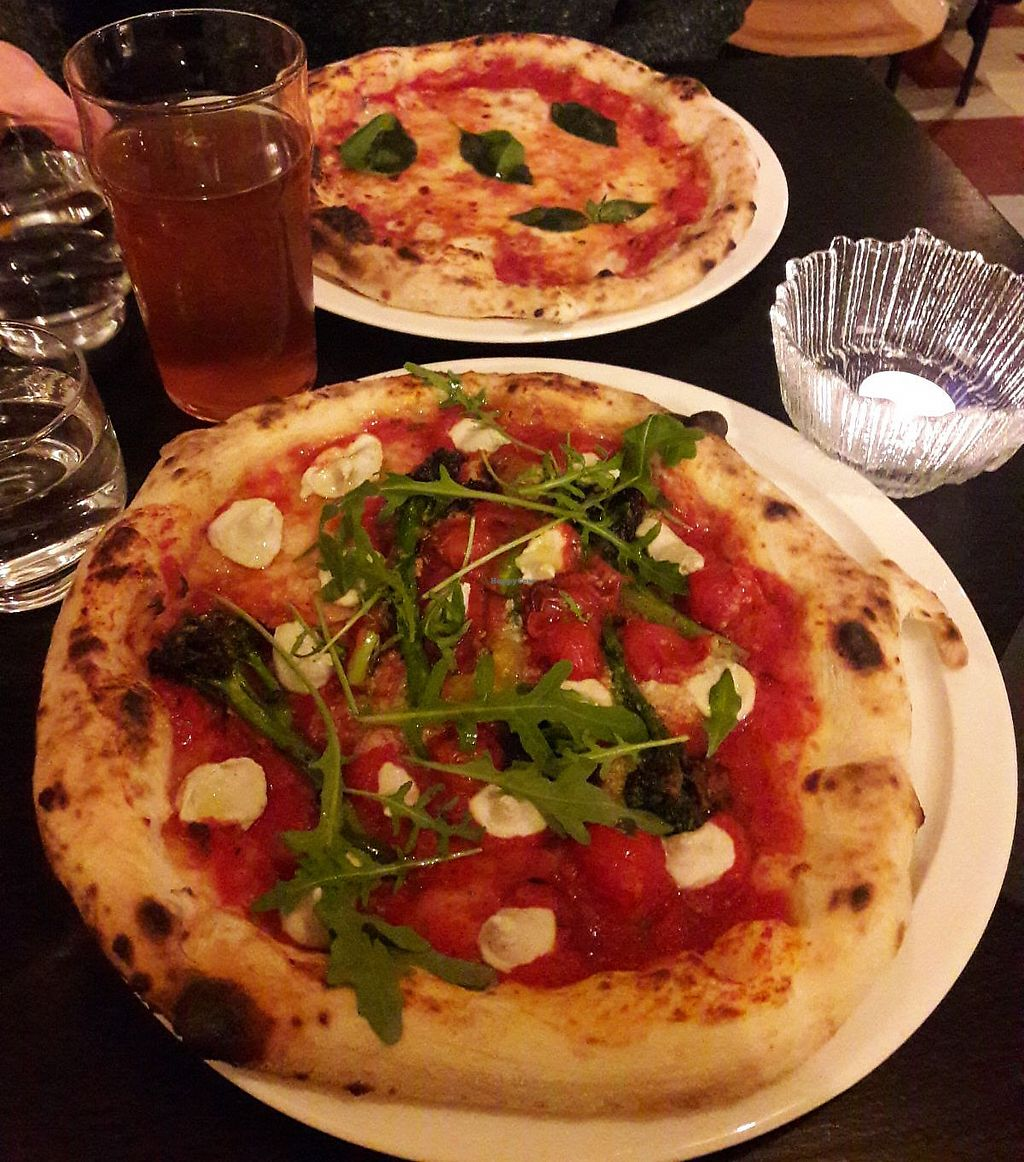 "Photo of Daddy Greens Pizzabar  by <a href=""/members/profile/cybermidget"">cybermidget</a> <br/>""In-A-Godda-Da-Vegan"" pizza with broccolini, arugula and vegan ricotta. Background: margherita <br/> December 13, 2017  - <a href='/contact/abuse/image/106924/335323'>Report</a>"