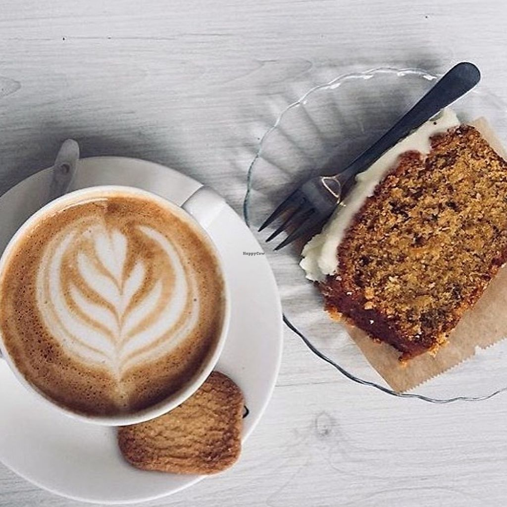 """Photo of Bairro Alto  by <a href=""""/members/profile/isalovesveganfood"""">isalovesveganfood</a> <br/>cappuccino with vegan pumpkin spice cake <br/> December 11, 2017  - <a href='/contact/abuse/image/107006/334545'>Report</a>"""