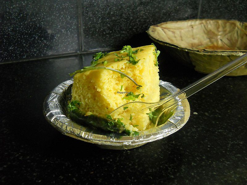 """Photo of Gautam Sweets - Tip Top  by <a href=""""/members/profile/Masala-Dosa"""">Masala-Dosa</a> <br/>Dhokla (a Gujarati breakfast dish) <br/> December 17, 2017  - <a href='/contact/abuse/image/107231/336394'>Report</a>"""